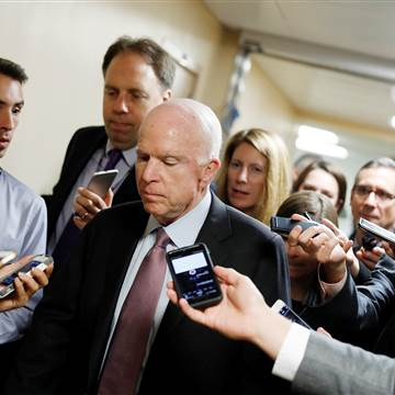 Image: Sen. John McCain (R-AZ) speaks with reporters ahead of the party luncheons on Capitol Hill in Washington