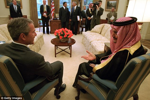 President George W. Bush sits and chats with Foreign Minister Saudi Al-Fail of Saudi Arabia in the Oval Office, Washington, District of Columbia, September 20, 2001