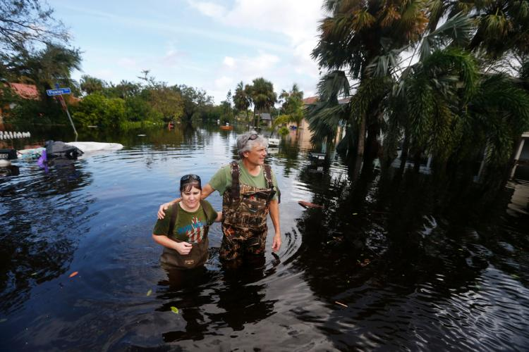 Kelly McClenthen returns to see the flood damage to her home with her boyfriend Daniel Harrison in the aftermath of Hurricane Irma in Bonita Springs, Fla., Monday.
