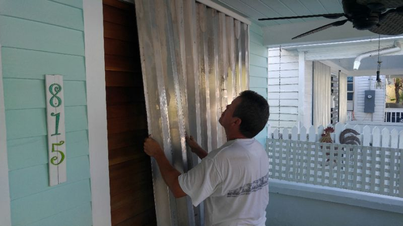 David Amendt protects his house in Key West, Florida, on September 6, 2017 ahead of Hurricane Irma