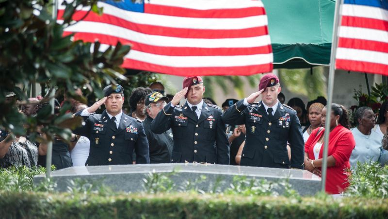 Comrades salute the casket of US Army Sergeant La David Johnson, who was one of four US soldiers killed in the Niger ambush