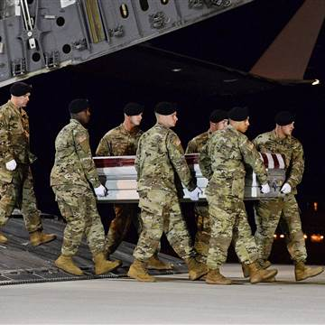 Image: A U.S. Army carry team transfers the remains of Army Staff Sgt. Dustin Wright at Dover Air Force Base in Delaware