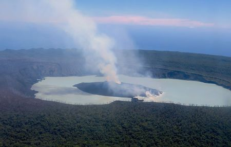 Smoke and ash emanates from the Manaro Voui volcano located on Vanuatu's northern island Ambae in the South Pacific
