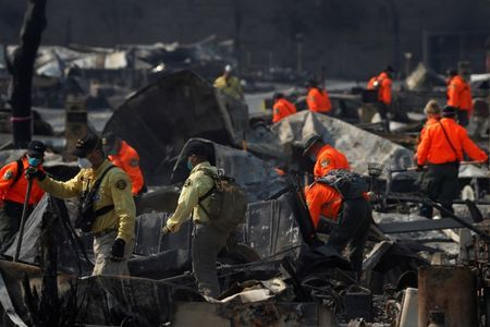Search and Rescue teams search for two missing people amongst ruins at Journey's End Mobile Home Park destroyed by the Tubbs Fire in Santa Rosa.    REUTERS/Stephen Lam