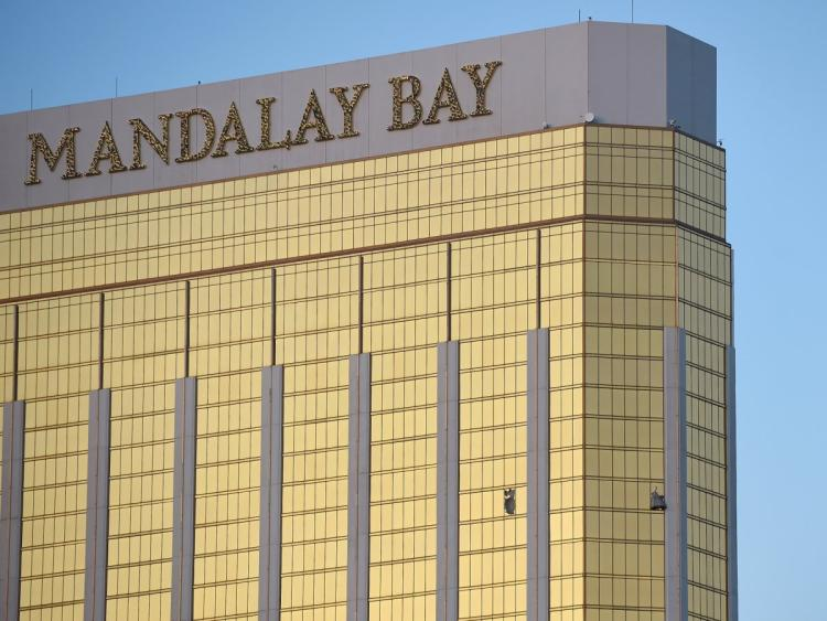 Broken windows are seen on the 32nd floor of the Mandalay Bay Resort and Casino after a lone gunman opened fired on the Route 91 Harvest country music festival