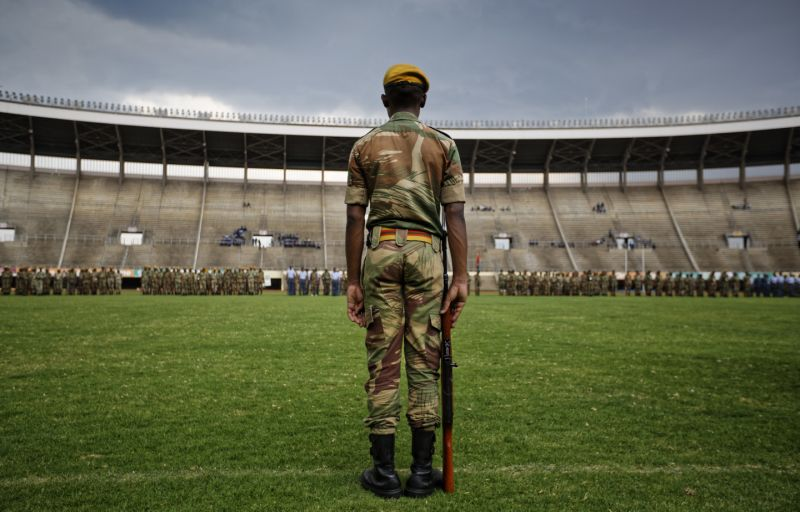 A Zimbabwean soldier stands to attention during a dress rehearsal ahead of Friday's presidential inauguration of Emmerson Mnangagwa, at the National Sports Stadium in Harare, Zimbabwe Thursday, Nov. 23, 2017. Zimbabwe on Thursday was making preparations to swear in a new leader after 37-years of Robert Mugabe rule. (AP Photo/Ben Curtis)