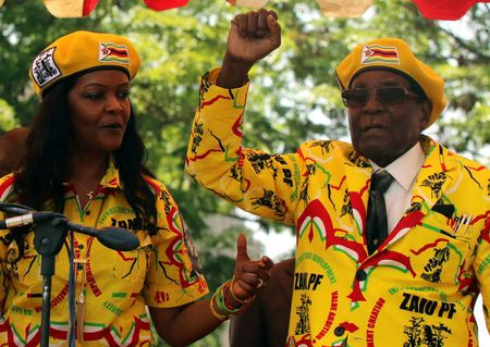 FILE PHOTO - President Robert Mugabe and his wife Grace Mugabe attend a rally of his ruling ZANU-PF party in Harare