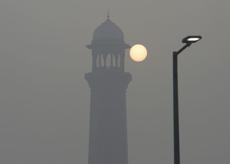 The sun raises next to the minaret of the historical Badshahi Mosque while smog envelopes the area in Lahore, Pakistan, Sunday, Nov. 5, 2017. Smog has enveloped much of Pakistan and neighboring India, causing highway accidents and respiratory problems, and forcing many residents to stay home, officials said. (AP Photo/K.M. Chaudary)