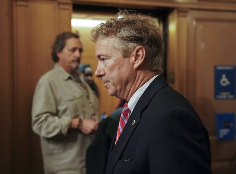 FILE- In this Nov. 13, 2017 file photo, Sen. Rand Paul, R-Ky., arrives on Capitol Hill in Washington.  Paul says a man who tackled him in his yard spoke to him afterward about why he was unhappy, but Paul said no explanation would have justified what he called an unprovoked attack. Paul spoke about the assault for the first time publicly with the Fox News Channel, which aired a portion of the interview on its website Tuesday, Nov. 28. (AP Photo/Pablo Martinez Monsivais, File)