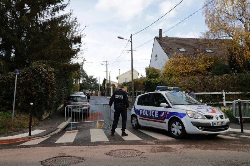 Police officers in Sarcelles, France, on Sunday near the scene where an officer shot his girlfriend, seriously wounding her, before killing there other people