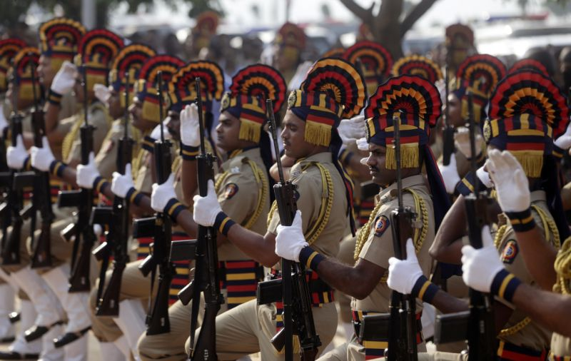 Indian police officers pay tribute to the victims of the Mumbai terror attacks at the memorial on its ninth anniversary in Mumbai, India, Sunday, Nov. 26, 2017. The attack by Pakistani gunmen in India's financial capital on Nov. 26, 2008 killed 166 people and shattered relations between the nuclear-armed neighbors. (AP Photo/Rafiq Maqbool)