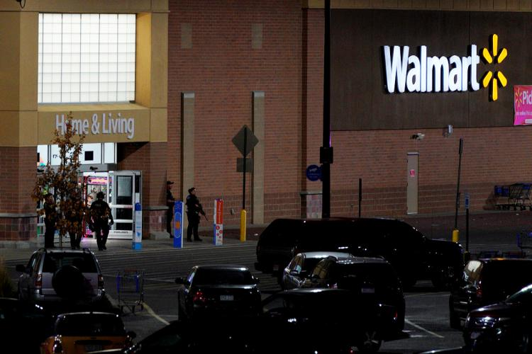Police guard the entrance at the scene of a shooting at a Walmart in Thornton, Colo., on Wednesday night.