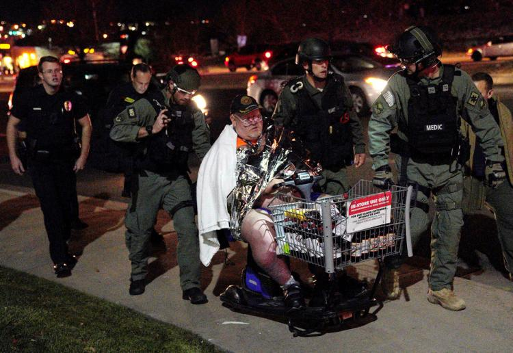 Patrick Carnes is evacuated in a Walmart cart by SWAT medics from the scene of a shooting at Colorado Walmart where Carnes had been shopping Wednesday evening.