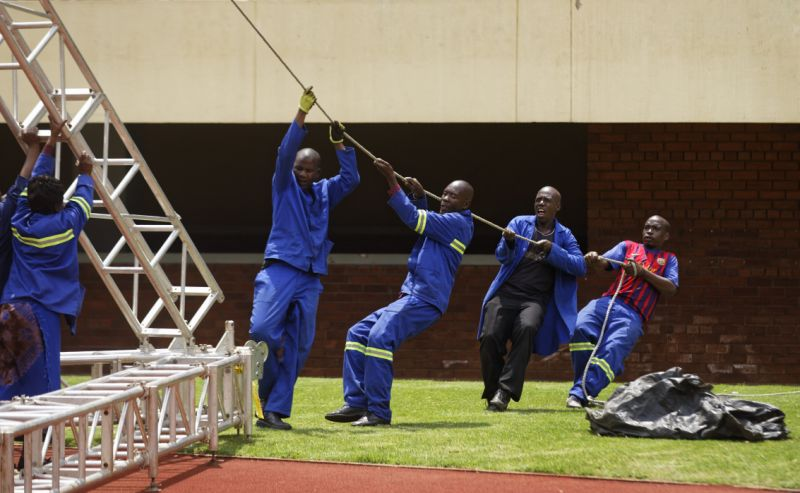Workers erect stands ahead of Friday's presidential inauguration of Emmerson Mnangagwa, at the National Sports Stadium in Harare, Zimbabwe Thursday, Nov. 23, 2017. Zimbabwe on Thursday was making preparations to swear in a new leader after 37 years. (AP Photo/Ben Curtis)