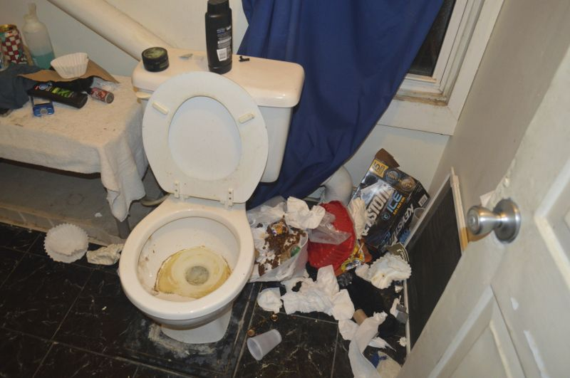 In this Nov. 29, 2017 photo provided by the Brockport Police Department in Brockport, N.Y., filthy conditions inside a bathroom at a house belonging to an unsanctioned fraternity near Brockport College are shown. Police arrested members of the unrecognized fraternity at the New York state college on Thursday, Dec. 7, 2017. Charges included various misdemeanor counts of hazing, criminal nuisance, assault and alcohol-related unlawfully dealing with a child. One of the men was charged with criminal possession of a controlled substance and two with animal cruelty. (Brockport Police Department via AP)