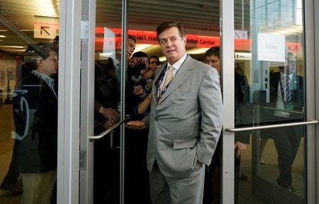 FILE PHOTO: Manafort, campaign manager to Republican Presidential Candidate Trump, escapes a mob of reporters  in Cleveland
