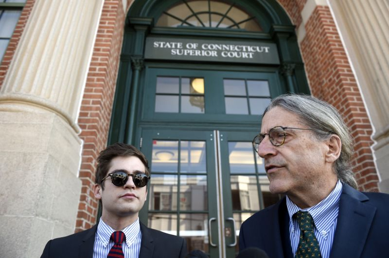 Lucian Wintrich, left, White House correspondent for the right-wing blog Gateway Pundit, takes questions from the media with his attorney Norman Pattis, right, outside Rockville Superior Court in Vernon, Conn., Monday, Dec. 11, 2017. Charges of breach of peace against Wintrich were dropped stemming from a Nov 28 incident at the University of Connecticut at which Wintrich delivered a speech titled
