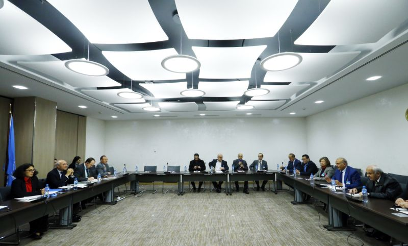 Members of the delegation of the Syrian Negotiation Commission (SNC) attend a meeting with United Nations Deputy Special Envoy for Syria Ramzy Ezzeldin Ramzy during the Intra Syria talks in Geneva, Switzerland, Friday, Dec. 1, 2017. (Denis Balibouse/Pool Photo via AP)