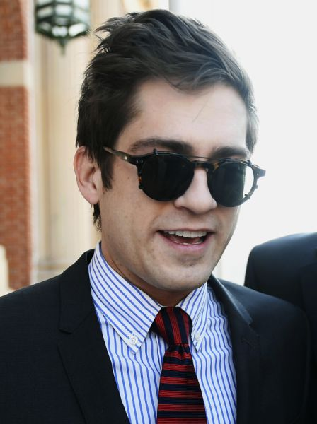 Lucian Wintrich, White House correspondent for the right-wing blog Gateway Pundit, leaves Rockville Superior Court in Vernon, Conn., Monday, Dec. 11, 2017. Charges of breach of peace against Wintrich were dropped stemming from a Nov 28 incident at the University of Connecticut at which Wintrich delivered a speech titled